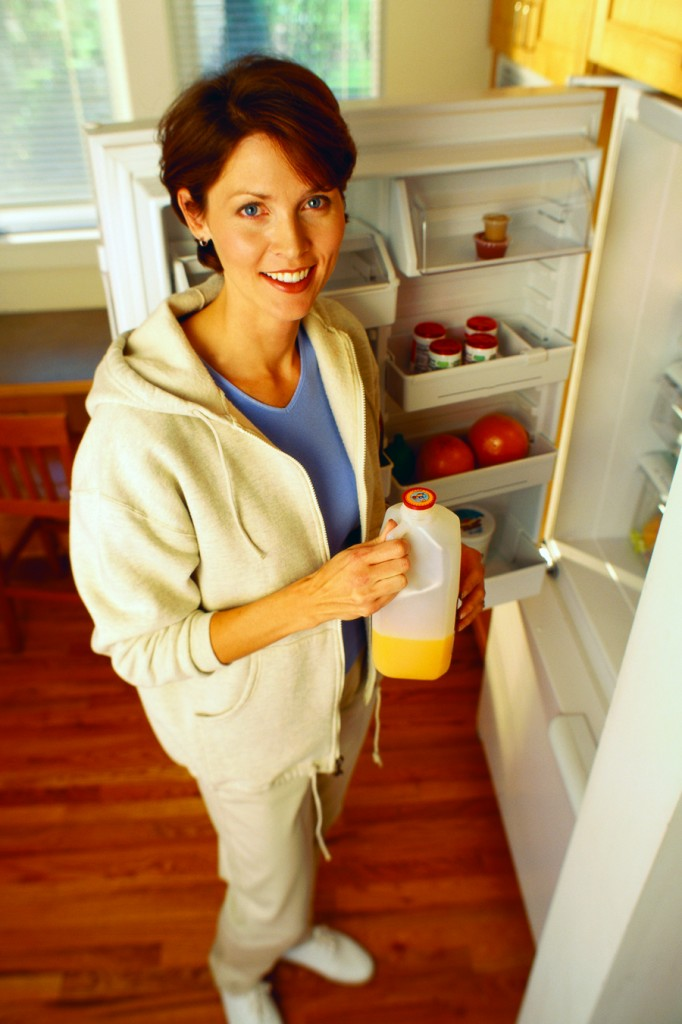 lady with fridge open